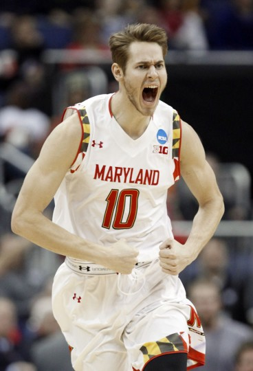 Maryland's Jake Layman reacts after a shot against West Virginia in the first half of an NCAA tournament college basketball game in the Round of 32 in Columbus, Ohio, Sunday, March 22, 2015. (AP Photo/Paul Vernon)