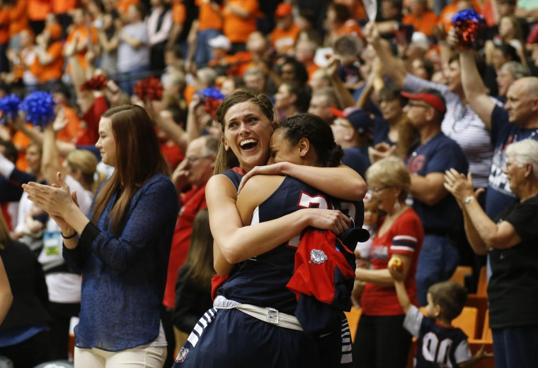Gonzaga's Elle Tinkle, center, and Shaniqua Nilles celebrate as time runs down in the team's 76-64 victory over Oregon State in a college basketball game in the second round of the NCAA women's tournament in Corvallis, Ore., Sunday, March 22, 2015. (AP Photo/Timothy J. Gonzalez)