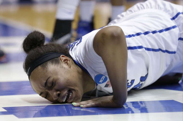Duke's Kendall Cooper grimaces following an injury during the second half of a women's college basketball game against Mississippi State in the second round of the NCAA tournament in Durham, N.C., Sunday, March 22, 2015. Duke won 64-56 to advance to the Spokane regional. (AP Photo/Gerry Broome)