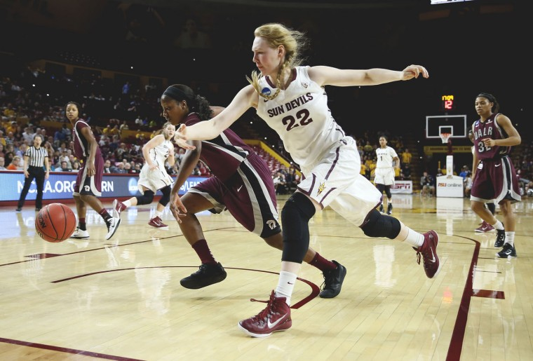 Arkansas Little Rock forward Kiera Clark, left, and Arizona State center Quinn Dornstauder (22) chase down the ball during the second half of a women's second round NCAA tournament college basketball game, Monday, March 23, 2015, Tempe, Ariz. Arizona State won 57-54. (AP Photo/Matt York)