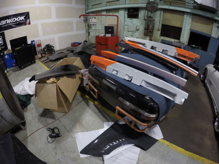 Somewhere beneath all those spare parts is my practice car. Today we will be installing a lot these freshly painted body panels onto the competition chassis. It's exciting to finally see the cars come together.