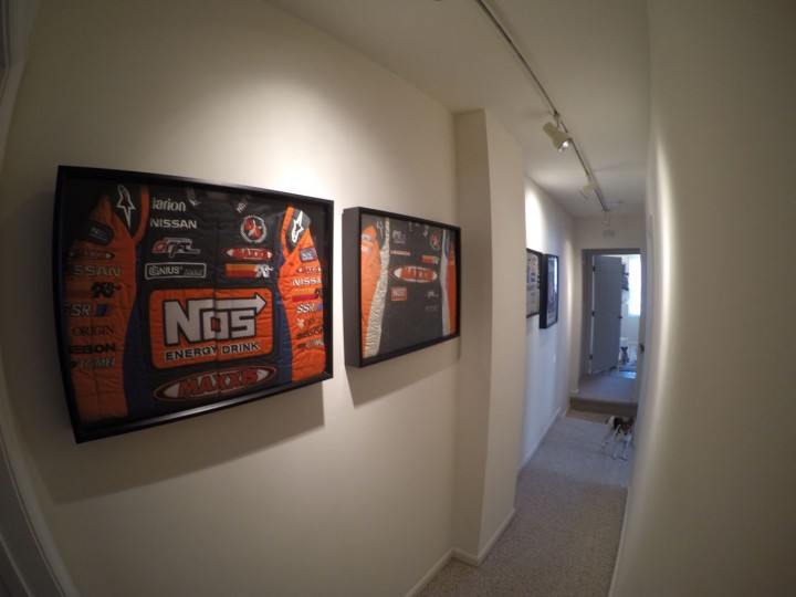 Hanging in the hallway are some of my old race suits. Each represents a milestone for me -- my first big sponsor, my first championship, etc.