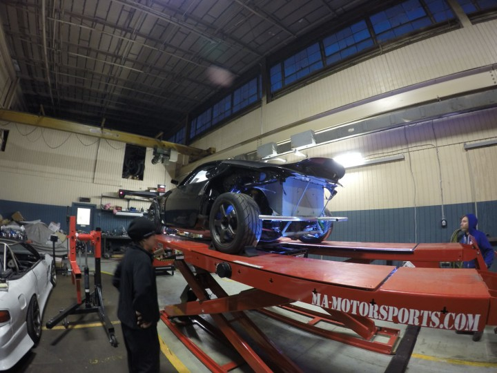 Brian and Ray getting the car on the alignment rack for final setup. I will now hop in the car and we use individual weight scales under each tire to adjust the springs to balance the car perfectly on all four corners.