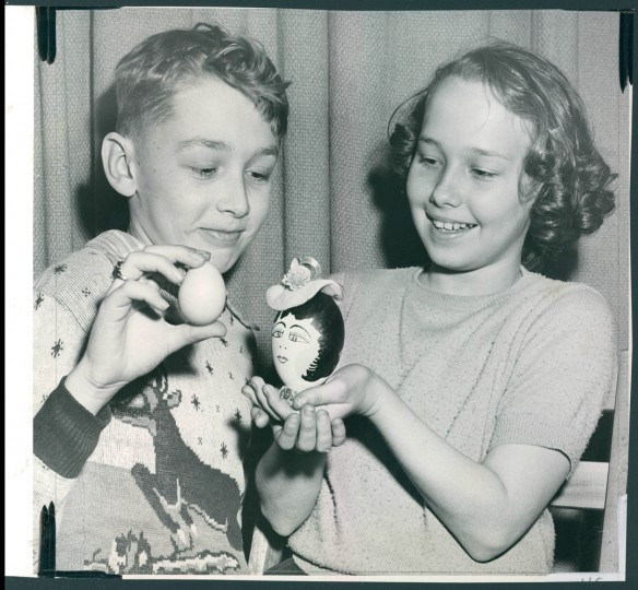 March 27, 1951- Contest winners are Russell Volker, 12, had smallest chicken egg and Suzanne Turnbull, 10, largest egg (goose egg). (Baltimore Sun Staff Photographer William L. Klender)