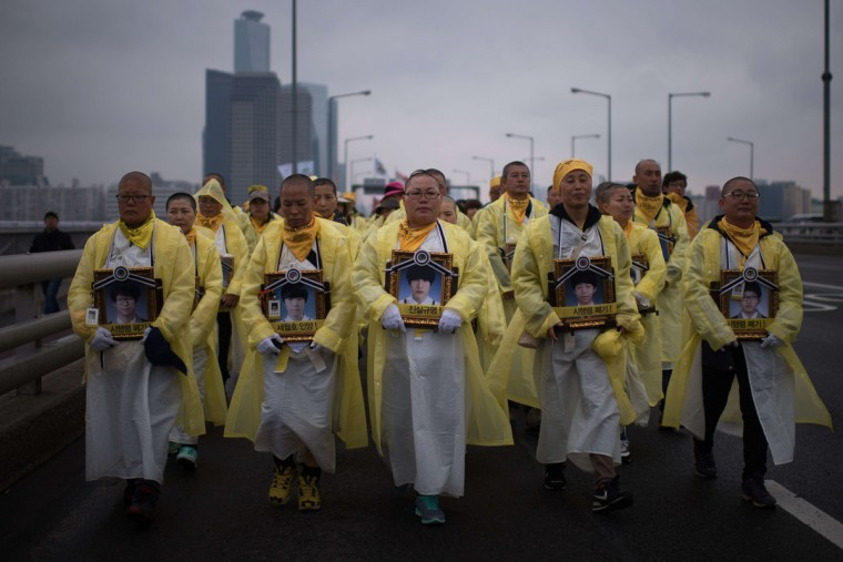 Relatives of victims of the Sewol ferry disaster march across a bridge over the Han river in Seoul on April 5, 2015. More than 200 people are participating in the march from Ansan city to the capital Seoul, mostly the parents of the 250 students from the same high school who perished when the overloaded ferry sank off the southern island of Jindo on April 16. Ed Jones/AFP Getty Images