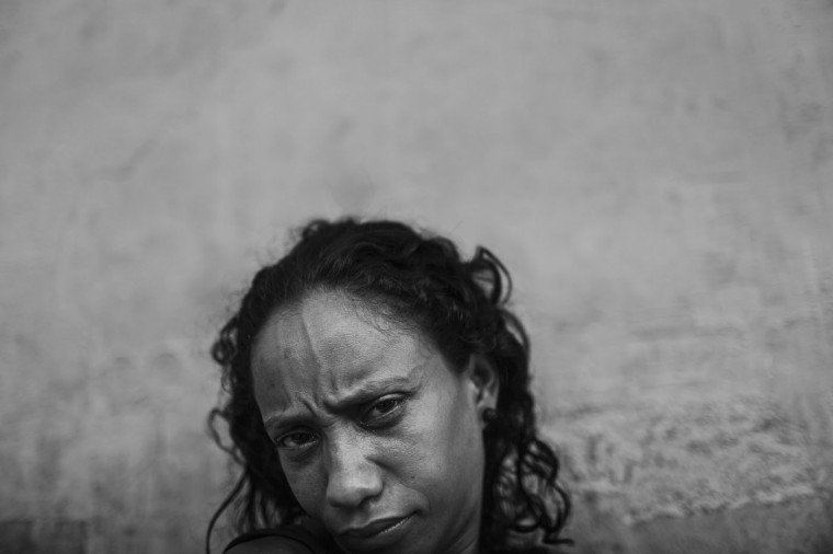 Michelle poses in the Centro neighborhood on March 26, 2015 in Rio de Janeiro, Brazil. Michelle said she has lived in the streets since she was 7 years old.