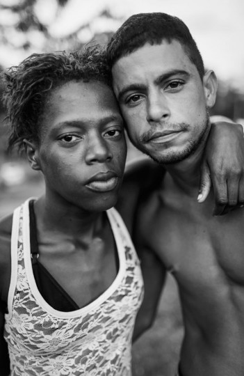 Couple Raissa Gomes (L) and Rafael Carneiro, who are homeless, pose in the park where they live in the West Zone on March 27, 2015 in Rio de Janeiro, Brazil.
