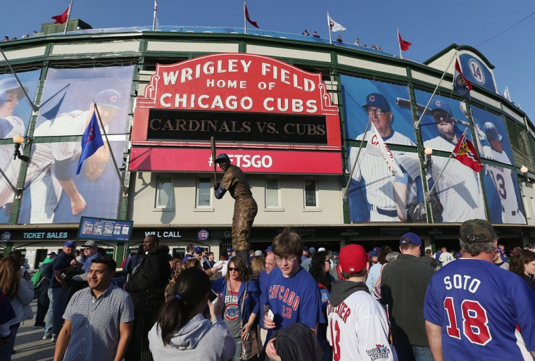 Fans gather outside of Wrigley Field before the Opening Night game between the Chicago Cubs and the St. Louis Cardinals on April 5, 2015 in Chicago, Illinois. (Photo by Jonathan Daniel/Getty Images)