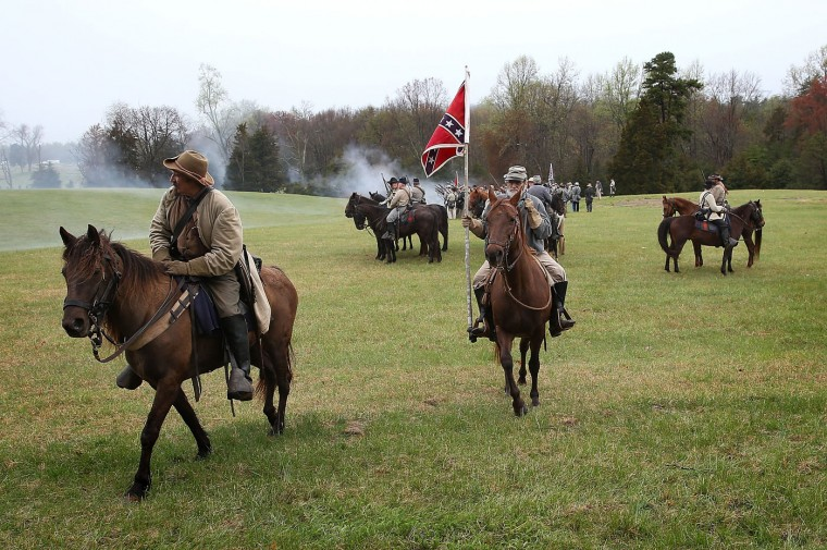 American Civil War re-enactors dressed as Confederate cavalry and infantry take part in a re-enactment of the Battle of Appomattox at the Appomattox Court House National Historical Park April 9, 2015 in Appomattox, Virginia. Today is the 150th anniversary of Confederate General Robert E. Lee's surrender of the Army of Northern Virginia to Union forces commanded by General Ulysses S. Grant in the McLean House at Appomattox, Virginia. The surrender marked the beginning of the end of the American Civil War in 1865. (Photo by Win McNamee/Getty Images)
