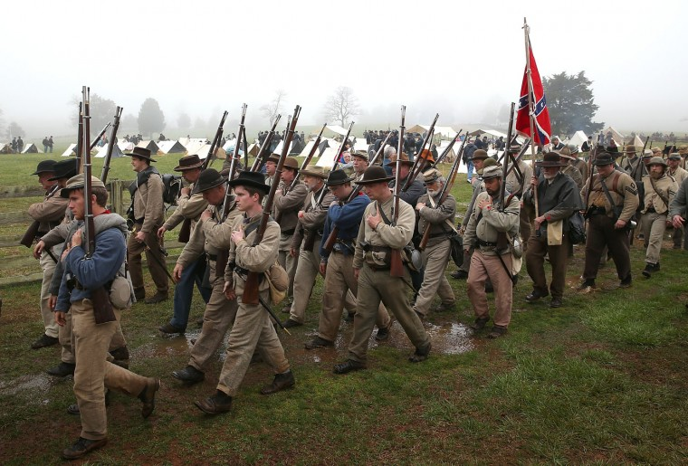 American Civil War re-enactors acting as members of the North Carolina 26th Infantry leave the field of battle following a re-enactment of the Battle of Appomattox Court House at the Appomattox Court House National Historical Park April 9, 2015 in Appomattox, Virginia. Today is the 150th anniversary of Confederate General Robert E. Lee's surrender of the Army of Northern Virginia to Union forces commanded by General Ulysses S. Grant in the McLean House at Appomattox, Virginia. The surrender marked the beginning of the end of the American Civil War in 1865. (Photo by Win McNamee/Getty Images)