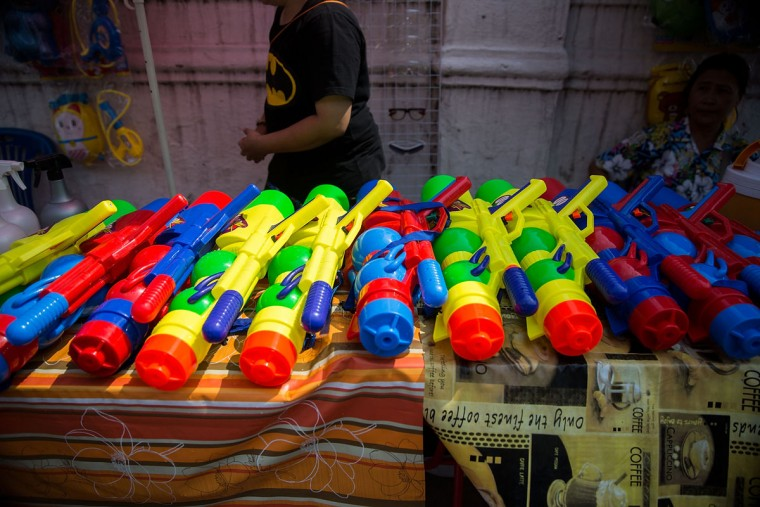 Large waterguns are sold from stalls all over the city during the Songkran festival on April 13, 2015 in Chiang Mai, Thailand. The Songkran festival, marking the traditional Thai New Year, is celebrated each year from April 13 to 15. The throwing of water was traditionally a sign of respect and well wishing during the festival. (Photo by Taylor Weidman/Getty Images)