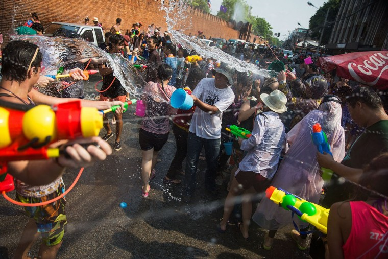 Thai locals and foreigners take part in a city-wide water fight on April 13, 2015 in Chiang Mai, Thailand. The Songkran festival, marking the traditional Thai New Year, is celebrated each year from April 13 to 15. The throwing of water was traditionally a sign of respect and well wishing during the festival. (Photo by Taylor Weidman/Getty Images)