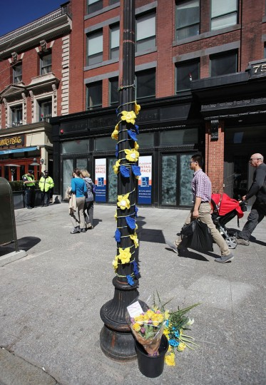 People walk past a memorial on Boylston Street commemorating the two-year anniversary of the 2013 Boston Marathon bombings, on April 15, 2015 in Boston, Massachusetts. Two years ago, two pressure cooker bombs killed three and injured an estimated 264 others during the Boston marathon on April 15, 2013. (Photo by Tim Bradbury/Getty Images)