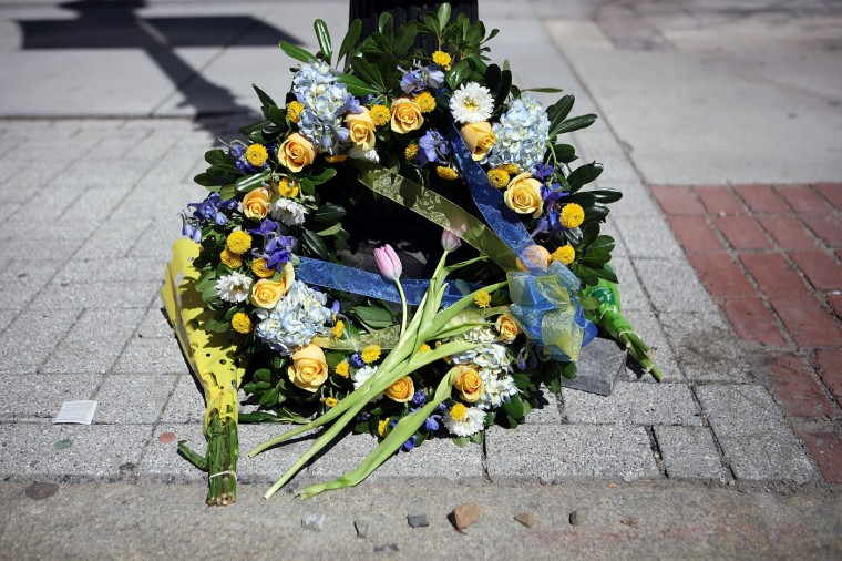 A detailed view of a wreath placed on a sidewalk on Boylston Street commemorating the two-year anniversary of the 2013 Boston Marathon bombings, on April 15, 2015 in Boston, Massachusetts. Two years ago, two pressure cooker bombs killed three and injured an estimated 264 others during the Boston marathon on April 15, 2013. (Photo by Tim Bradbury/Getty Images)
