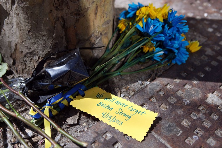 A detailed view of flowers placed on a sidewalk on Boylston Street commemorating the two-year anniversary of the 2013 Boston Marathon bombings, on April 15, 2015 in Boston, Massachusetts. Two years ago, two pressure cooker bombs killed three and injured an estimated 264 others during the Boston marathon on April 15, 2013. (Photo by Tim Bradbury/Getty Images)