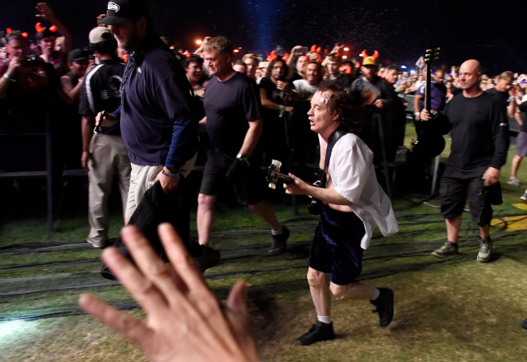 Musician Angus Young of AC/DC performs in the crowd during day 1 of the 2015 Coachella Valley Music And Arts Festival (Weekend 2) at The Empire Polo Club on April 17, 2015 in Indio, California. (Photo by Frazer Harrison/Getty Images for Coachella)