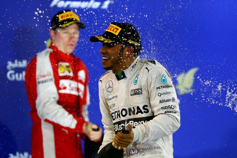 Lewis Hamilton of Great Britain and Mercedes GP celebrates on the podium after winning the Bahrain Formula One Grand Prix at Bahrain International Circuit on April 19, 2015 in Bahrain, Bahrain. (Dan Istitene/Getty Images)
