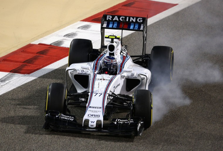 Valtteri Bottas of Finland and Williams locks up his brakes during the Bahrain Formula One Grand Prix at Bahrain International Circuit on April 19, 2015 in Bahrain, Bahrain. (Clive Mason/Getty Images)