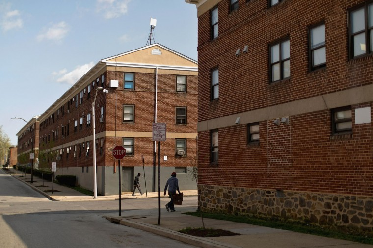 Video surveillance cameras are mounted to the outside of every Gilmor Homes housing project building near the place where Freddie Gray was arrested in the Sandtown neighborhood April 21, 2015 in Baltimore, Maryland. Gray, a 25-year-old black man who lived in the neighborhood, was arrested for possessing a switch blade knife April 12 outside this building on Baltimore's west side. According to his attorney, Gray died a week later in the hospital from a severe spinal cord injury he received while in police custody. (Photo by Chip Somodevilla/Getty Images)