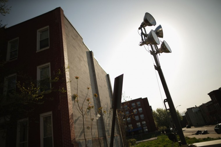An anti-crime light tower stands on a corner near the Baltimore Police Western District station, where Freddie Gray was taken after being arrested last week in the Sandtown neighborhood April 21, 2015 in Baltimore, Maryland. Gray, whose nickname was Pepper, was a 25-year-old black man who lived in this neighborhood and was arrested for possessing a switch blade knife April 12 outside the Gilmor Homes housing project on Baltimore's west side. According to his attorney, Gray died a week later in the hospital from a severe spinal cord injury he received while in police custody. (Photo by Chip Somodevilla/Getty Images)