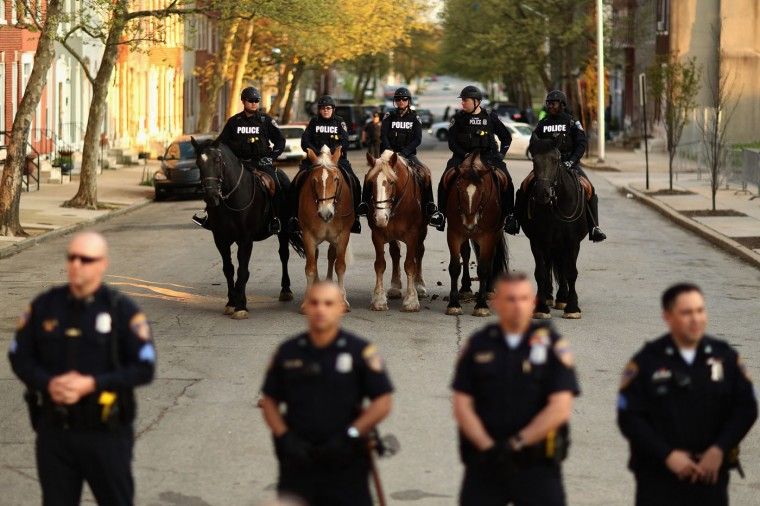 Baltimore Police mounted officers stand at the ready during a protest against police brutality and the death of Freddie Gray outside the Baltimore Police Western District station in the Sandtown neighborhood April 22, 2015 in Baltimore, Maryland. Gray, 25, was arrested for possessing a switch blade knife April 12 outside the Gilmor Homes housing project on Baltimore's west side. According to his attorney, Gray died a week later in the hospital from a severe spinal cord injury he received while in police custody. (Photo by Chip Somodevilla/Getty Images)