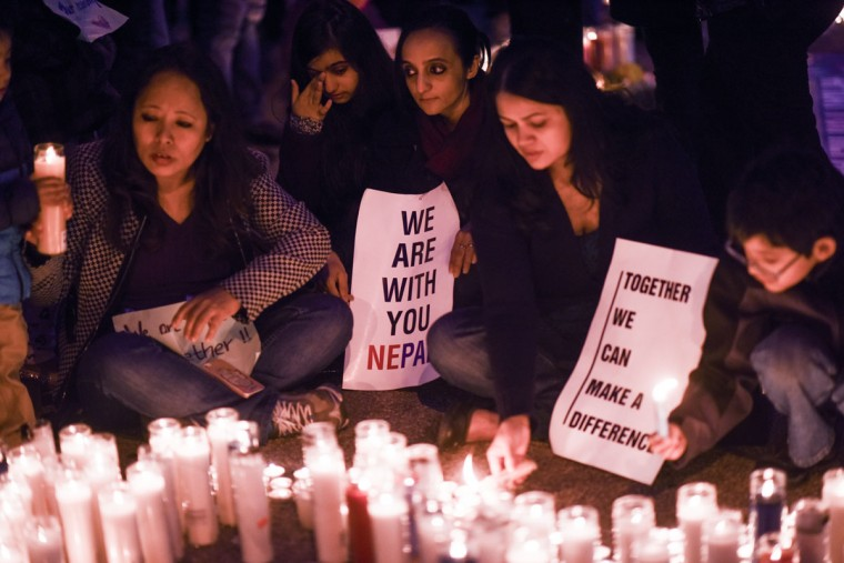 Mourners light candles in Diversity Square during a vigil for the victims of the earthquake in Nepal on April 26, 2015 in the Jackson Heights section of the Queens borough of New York City. A major 7.8 earthquake hit Kathmandu mid-day on Saturday, and was followed by multiple aftershocks that triggered avalanches on Mt. Everest that buried mountain climbers in their base camps. Many houses, buildings and temples in the capital were destroyed during the earthquake, leaving thousands dead or trapped under the debris as emergency rescue workers attempt to clear debris and find survivors. (Photo by Andrew Theodorakis/Getty Images).