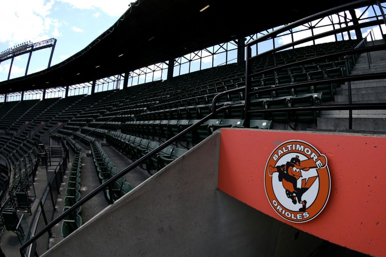 The stands are seen empty before the Baltimore Orioles play the Chicago White Sox at Oriole Park at Camden Yards on April 29, 2015 in Baltimore, Maryland. Due to unrest in relation to the arrest and death of Freddie Gray, the two teams played in a stadium closed to the public. Gray, 25, was arrested for possessing a switch blade knife April 12 outside the Gilmor Houses housing project on Baltimore's west side. According to his attorney, Gray died a week later in the hospital from a severe spinal cord injury he received while in police custody. (Photo by Patrick Smith/Getty Images)