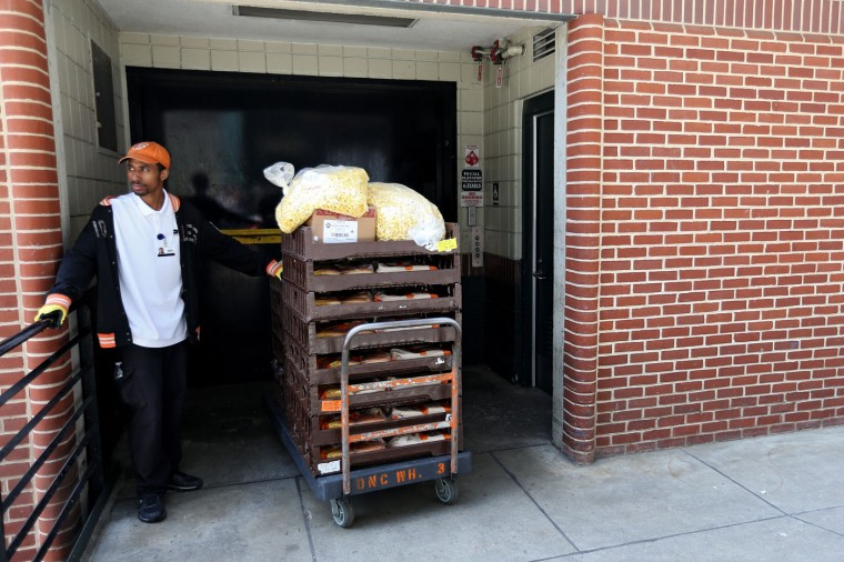 A vendor waits for an elevator after removing food from concessions before the Baltimore Orioles play the Chicago White Sox at an empty Oriole Park at Camden Yards on April 29, 2015 in Baltimore, Maryland. Due to unrest in relation to the arrest and death of Freddie Gray, the two teams played in a stadium closed to the public. Gray, 25, was arrested for possessing a switch blade knife April 12 outside the Gilmor Houses housing project on Baltimore's west side. According to his attorney, Gray died a week later in the hospital from a severe spinal cord injury he received while in police custody. (Photo by Patrick Smith/Getty Images)