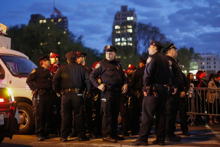 NYPD Officers stand watch during a Solidarity With City Of Baltimore protest on April 29, 2015 in New York City. Baltimore, Maryland remains on edge in the wake of the death of Freddie Gray, though the city has been largely peaceful following a day of rioting this past Monday. Gray, 25, was arrested for possessing a switch blade knife April 12 outside the Gilmor Houses housing project on Baltimore's west side. According to his attorney, Gray died a week later in the hospital from a severe spinal cord injury he received while in police. (Kena Betancur/Getty Images)
