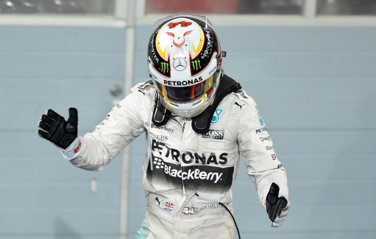 Mercedes AMG Petronas British driver Lewis Hamilton gestures towards to his teammates as he celebrates after winning the Formula One Bahrain Grand Prix at the Sakhir circuit in the desert south of the Bahraini capital, Manama, on April 19, 2015. (Fayez Nureldine/AFP/Getty Images)