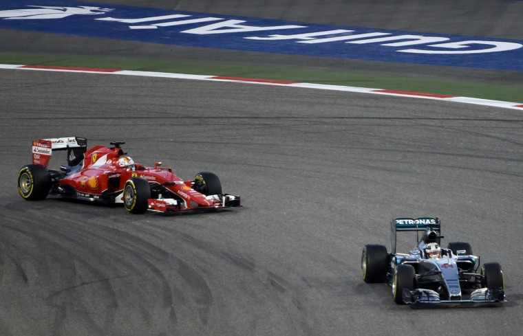 Mercedes AMG Petronas British driver Lewis Hamilton and Scuderia Ferrari German driver Sebastian Vettel compete during the Formula One Bahrain Grand Prix at the Sakhir circuit in the desert south of the Bahraini capital, Manama, on April 19, 2015. (Fayez Nureldine/AFP/Getty Images)