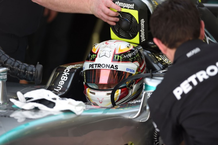 Mechanics check Mercedes AMG Petronas British driver Lewis Hamilton before the Formula One Bahrain Grand Prix at the Sakhir circuit in the desert south of the Bahraini capital, Manama, on April 19, 2015. (Fayez Nureldine/AFP/Getty Images)