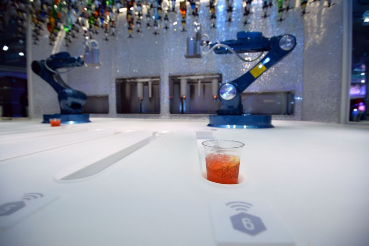 Robots make cocktails, ordered via a tablet in the bionic bar on board Royal Caribbean's latest cruise liner 'The Anthem Of The Seas', a 4,905-passenger ship which is docked in Southampton on April 20, 2015. (GLYN KIRK/AFP/Getty Images)