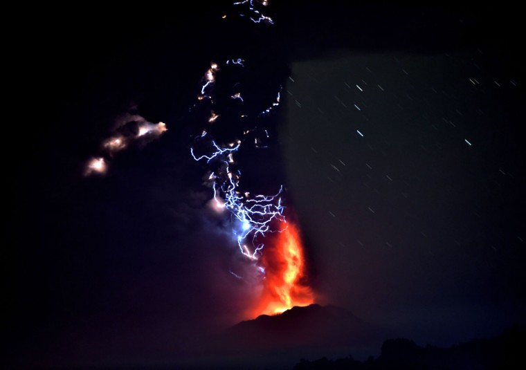 View from Frutillar, southern Chile, of lava spewing from the Calbuco volcano, on April 23, 2015. Chile's Calbuco volcano erupted on Wednesday, spewing a giant funnel of ash high into the sky near the southern port city of Puerto Montt and triggering a red alert. Authorities ordered an evacuation for a 10-kilometer (six-mile) radius around the volcano, which is the second in southern Chile to have a substantial eruption since March 3, when the Villarrica volcano emitted a brief but fiery burst of ash and lava. (AFP Photo/P /martin )