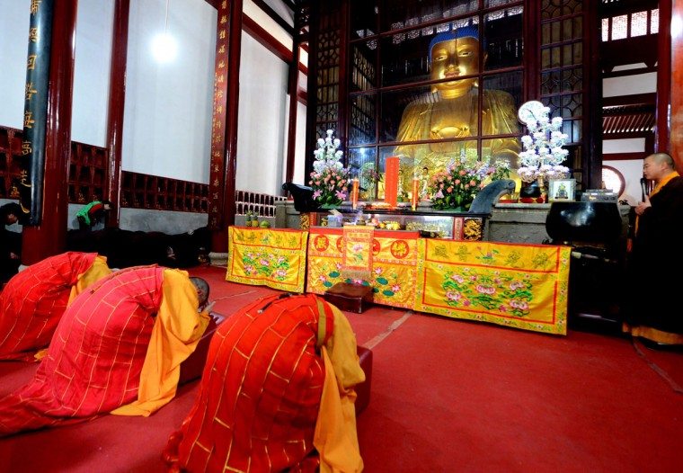 Monks bow to a Buddha statue as some 300 Buddhists gather to pray for Nepal earthquake victims in Kaiyuan Temple in Fuzhou, east China's Fujian province on April 26, 2015. Aid groups and governments worldwide intensified efforts to help earthquake-hit Nepal, but blocked roads, downed power lines and overcrowded hospitals posed formidable challenges in an already poor country. (AFP Photo/P /afp/getty )