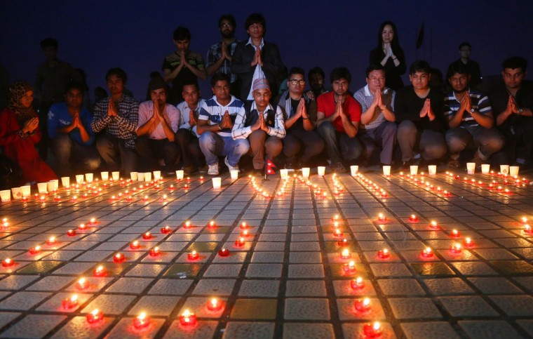 Nepalese students and Chinese students gathering to pray for Nepal in Nanhua University in Hengyang, central China's Hunan province. International rescue teams and relief supplies began arriving in Nepal's devastated capital on April 27 to help terrified and homeless survivors of a quake that has killed more than 3,200 people in the impoverished nation. (AFP Photo//afp/getty )