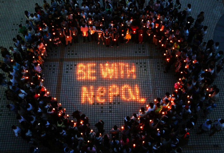 Nepalese students and Chinese students gathering to pray for Nepal in Nanhua University in Hengyang, central China's Hunan province. International rescue teams and relief supplies began arriving in Nepal's devastated capital on April 27 to help terrified and homeless survivors of a quake that has killed more than 3,200 people in the impoverished nation. AFP Photo/afp/getty )