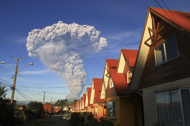 The Calbuco volcano is seen erupting from Puerto Varas, Chile, Wednesday, April 22, 2015. The volcano erupted billowing a huge ash cloud over a sparsely populated, mountainous area in southern Chile. Authorities ordered the evacuation of the inhabitants of the nearby town of Ensenada, along with residents of two smaller communities. (AP Photo/Carlos F. Gutierrez)