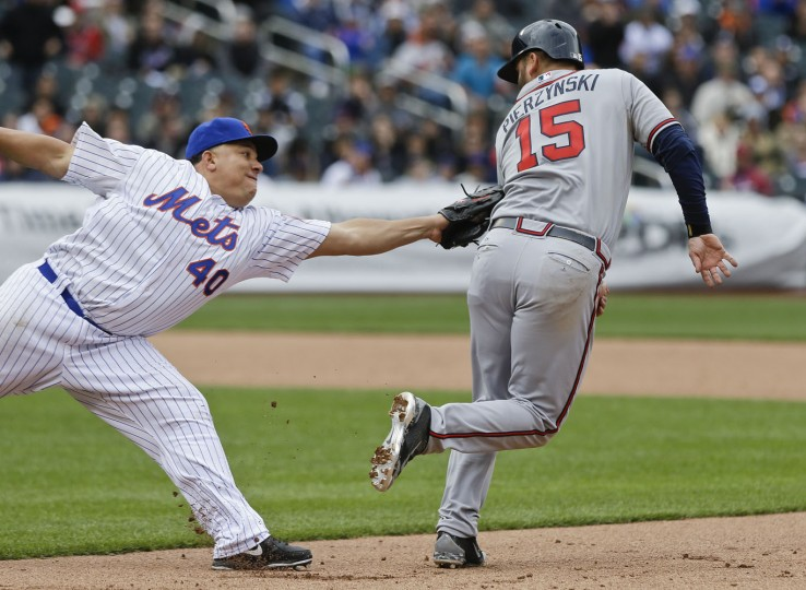 New York Mets' Bartolo Colon (40) tags out Atlanta Braves' A.J. Pierzynski (15) during the sixth inning of a baseball game Thursday, April 23, 2015, in New York. (AP Photo/Frank Franklin II)