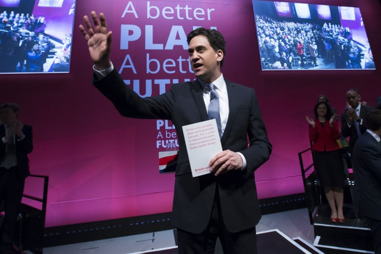 Labour Party Leader Ed Miliband waves as he arrives to speak at the launch of the party's election manifesto in Manchester, England, Monday April 13, 2015. Britain goes to the polls in a General Election on May 7. (AP Photo/Jon Super)
