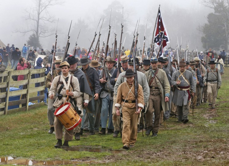 Confederate re-enactors march back to camp after a re-enactment of the Battle of Appomattox Court House as part of the commemoration of the 150th anniversary of the surrender of the Army of Northern Virginia at Appomattox Court House in Appomattox, Va., Thursday, April 9, 2015. The battle was the final battle of the army of Confederate General Robert E. Lee before his surrender to Union troops. (AP Photo/Steve Helber)