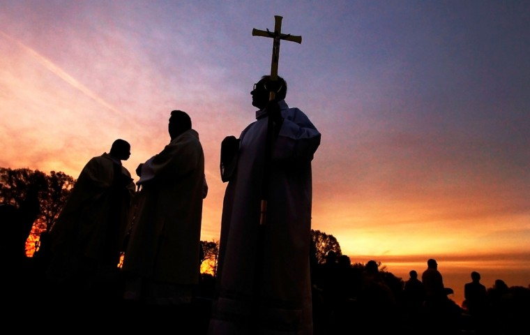 Bubba McArthur, center, waits with members of the clergy as they prepare for the opening processional during the 30th annual Easter Sunrise Mass at Calvary Cemetery, Sunday, April 5, 2015, in Memphis, Tenn. Jim Weber/AP