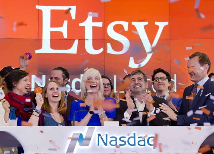 Kristina Salen, center left, Etsy's Chief Financial Officer, stands with Chad Dickerson, center right, Chairman and Chief Executive Officer of Etsy, to celebrate the company's IPO with employees and guests at the Nasdaq MarketSite, Thursday, April 16, 2015, in New York. (AP Photo/Mark Lennihan)