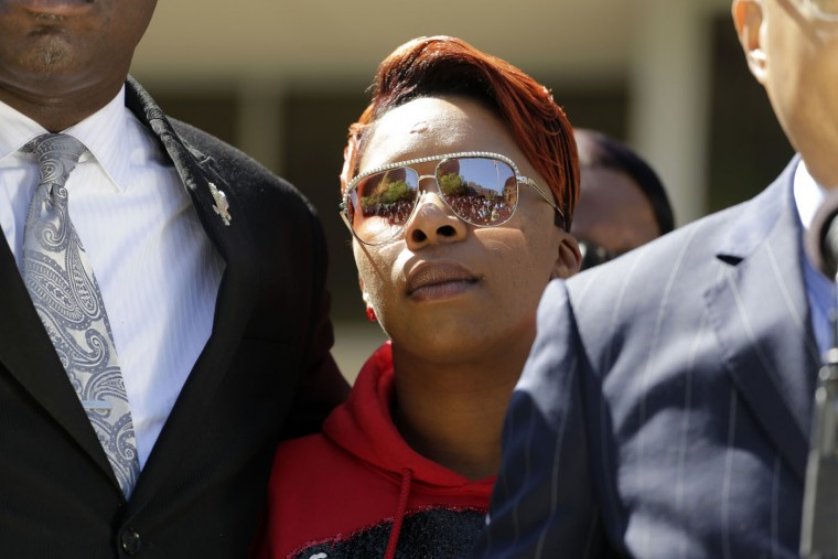 Lesley McSpadden, the mother of Michael Brown, listens during a news conference Thursday, April 23, 2015, in Clayton, Mo. The parents of Michael Brown filed a wrongful-death lawsuit Thursday against the city of Ferguson, Mo., over the fatal shooting of their son by a white police officer, a confrontation that sparked a protest movement across the United States. (AP Photo/Jeff Roberson)