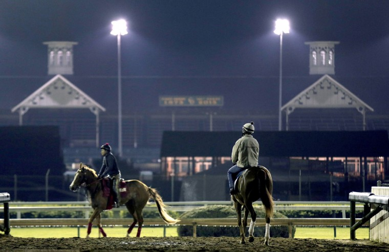 Horses train during an early during morning workout at Churchill Downs Wednesday, April 29, 2015, in Louisville, Ky. (AP Photo/Charlie Riedel)