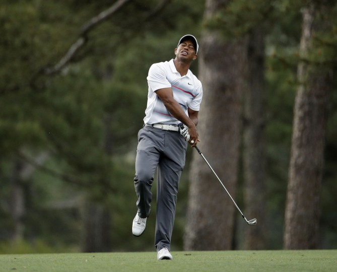 Tiger Woods reacts to his shot on the 14th hole during the first round of the Masters golf tournament Thursday, April 9, 2015, in Augusta, Ga. (AP Photo/Charlie Riedel)