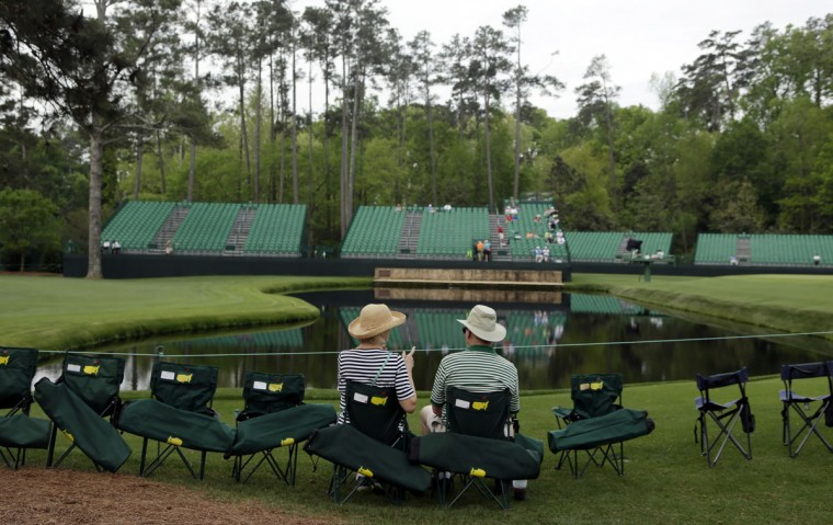 Spectators wait at the 16th hole for golfers to play through during the second round of the Masters golf tournament Friday, April 10, 2015, in Augusta, Ga. (AP Photo/Charlie Riedel)