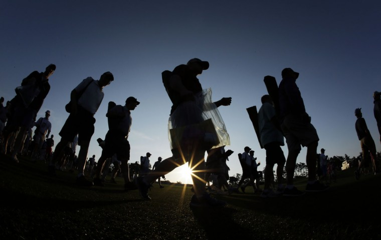 Spectators walk along the first fairway before the first round of the Masters golf tournament Thursday, April 9, 2015, in Augusta, Ga. (AP Photo/Matt Slocum)