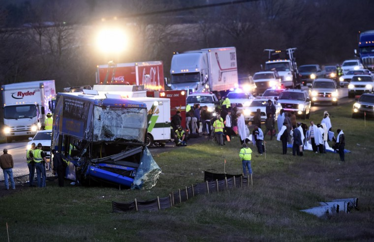 Authorities work the scene of a four-vehicle crash involving a Megabus on southbound Interstate 65 near Edinburgh, Ind., Monday, April 13, 2015. Nineteen passengers suffered non-life-threatening injuries Monday morning when the bus, heading from Chicago to Atlanta, struck the back of a stopped semitrailer on Interstate 65, Indiana State Police said. (Scott Roberson/The Daily Journal via AP)