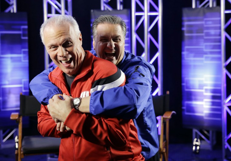 Wisconsin head coach Bo Ryan and Kentucky head coach John Calipari have some fun after a CBS Sports interview for their NCAA Final Four tournament college basketball semifinal game Thursday, April 2, 2015, in Indianapolis. (AP Photo/David J. Phillip)